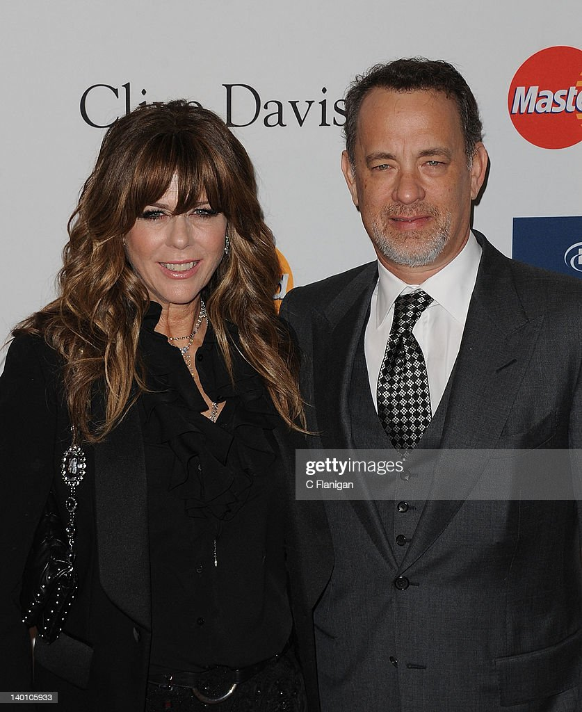 <a gi-track='captionPersonalityLinkClicked' href=/galleries/search?phrase=Rita+Wilson+-+Actress&family=editorial&specificpeople=202642 ng-click='$event.stopPropagation()'>Rita Wilson</a> and <a gi-track='captionPersonalityLinkClicked' href=/galleries/search?phrase=Tom+Hanks&family=editorial&specificpeople=201790 ng-click='$event.stopPropagation()'>Tom Hanks</a> arrive at Clive Davis and The Recording Academy's 2012 Salute To Industry Icons Gala at The Beverly Hilton hotel on February 11, 2012 in Beverly Hills, California.