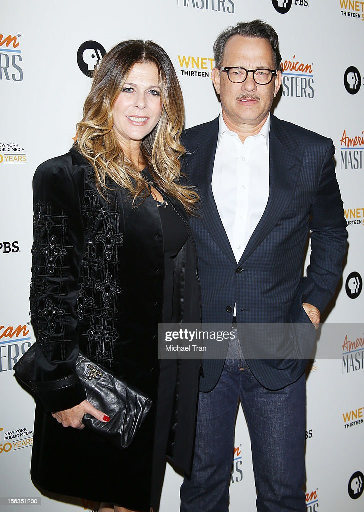 Rita Wilson (L) and Tom Hanks arrive at the Los Angeles premiere of 'Inventing David Geffen' held at Writer's Guild Theater on November 13, 2012 in Los Angeles, California.