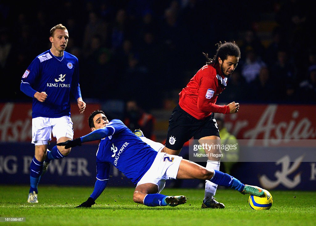 Ritchie De Laet and Anthony Knockaert of Leicester in action with Sean Scannell of Huddersfield during the FA Cup Fourth Round Replay between Leicester City and Huddersfield Town at The King Power Stadium on February 12, 2013 in Leicester, England.