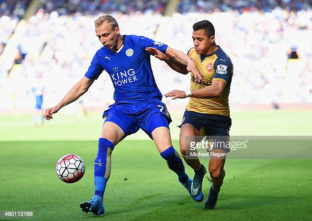 Ritchie De Laet of Leicester City and Alexis Sanchez of Arsenal compete for the ball during the Barclays Premier League match between Leicester City...