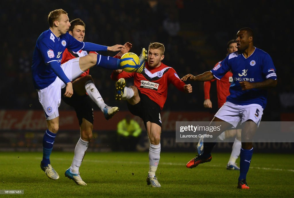 Ritchie De Laet of Leicester City battles with Adam Clayton of Huddersfield Town during the FA Cup with Budweiser Fourth Round replay match between Leicester City and Huddersfield Town at The King Power Stadium on February 12, 2013 in Leicester, England.