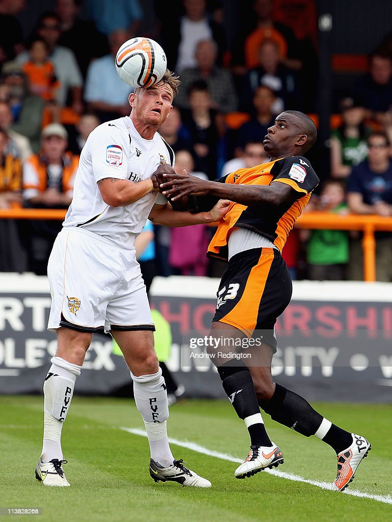 Ritchie Sutton of Port Vale (left) and Izale McLeod of Barnet battle for the ball during the npower League Two match between Barnet and Port Vale at Underhill Stadium on May 7, 2011 in Barnet, England.