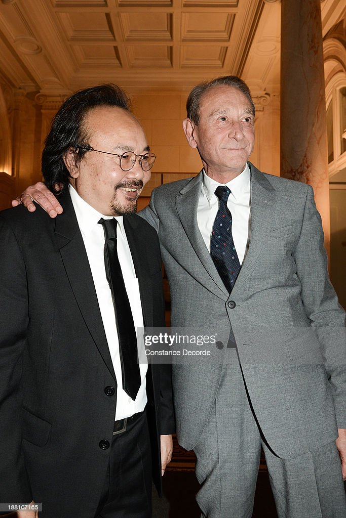 Rithy Panh (L) poses with Mayor of Paris, <a gi-track='captionPersonalityLinkClicked' href=/galleries/search?phrase=Bertrand+Delanoe&family=editorial&specificpeople=206163 ng-click='$event.stopPropagation()'>Bertrand Delanoe</a>, during a ceremony honouring Camobodian documentary filmmaker Rithy Panh at La Grande Medaille De La Ville De Paris at Mairie de Paris on November 15, 2013 in Paris, France.