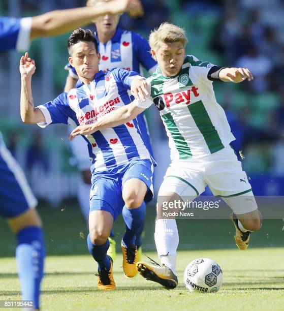 Ritsu Doan of FC Groningen and Japanese compatriot Yuki Kobayashi of Heerenveen compete for the ball in the teams' Eredivisie season opener on Aug 13...