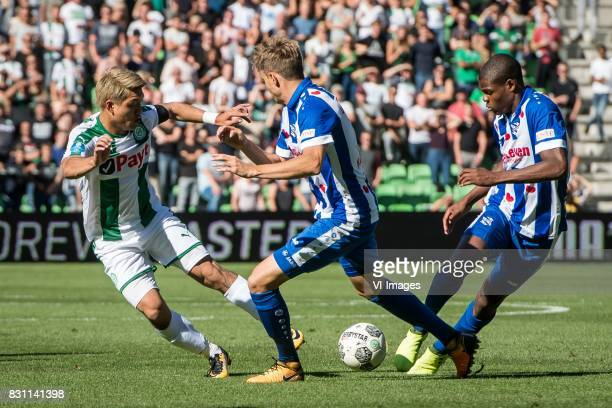 Ritsu Doan of FC Groningen Daniel Hoegh of sc Heerenveen Denzel Dumfries of sc Heerenveen during the Dutch Eredivisie match between FC Groningen and...