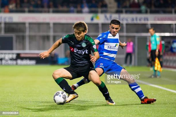 Ritsu Doan of FC Groningen Mustafa Saymak of PEC Zwolle during the Dutch Eredivisie match between PEC Zwolle and FC Groningen at the MAC3Park stadium...
