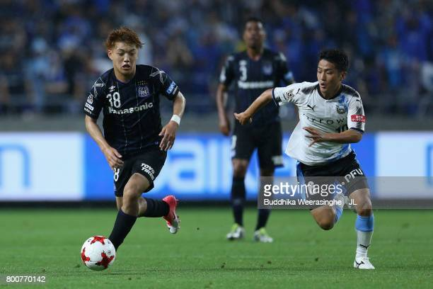 Ritsu Doan of Gamba Osaka and Ryota Oshima of Kawasaki Frontale compete for the ball during the JLeague J1 match between Gamba Osaka and Kawasaki...