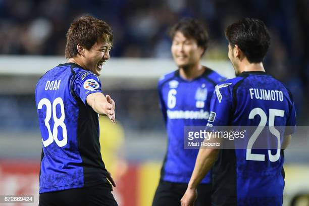 Ritsu Doan of Gamba Osaka celebrates scoring a goal with team mates during the AFC Champions League Group H match between Gamba Osaka v Adelaide...