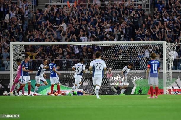 Ritsu Doan of Gamba Osaka celebrates scoring the opening goal with his team mates during the JLeague J1 match between Yokohama FMarinos and Gamba...