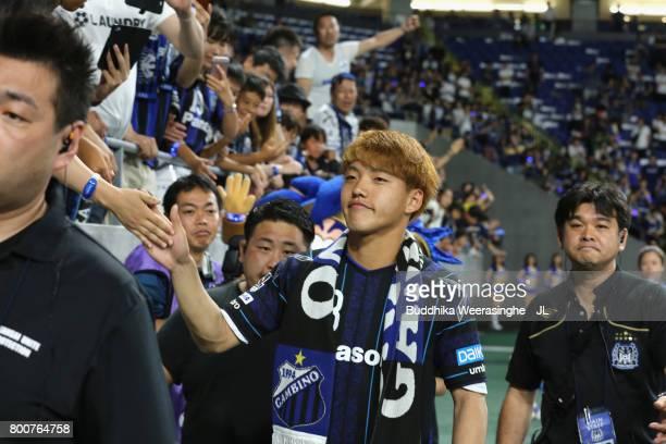 Ritsu Doan of Gamba Osaka high fives with supporters after the JLeague J1 match between Gamba Osaka and Kawasaki Frontale at Suita City Football...