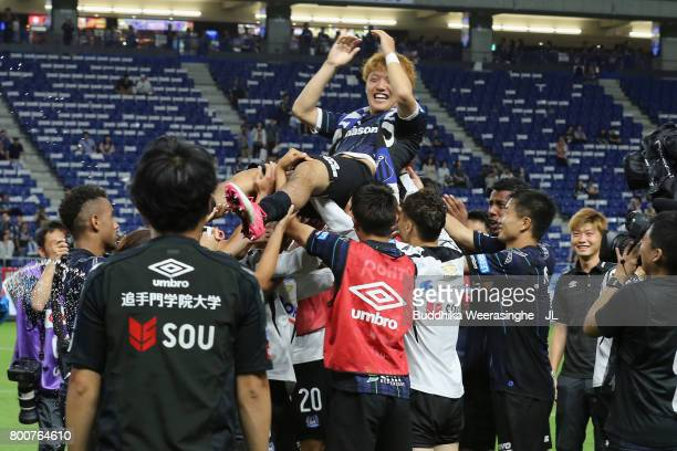 Ritsu Doan of Gamba Osaka is tossed into the air after a sending off ceremony as he joins Dutch side Groningen on loan after the JLeague J1 match...