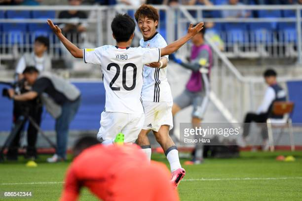 Ritsu Doan of Japan celebrates scoring his side's second goal with his team mate Takefusa Kubo during the FIFA U20 World Cup Korea Republic 2017...