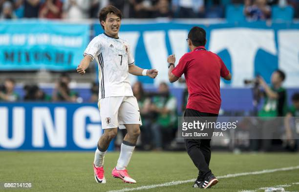 Ritsu Doan of Japan celebrates with head coach Atsushi Uchiyama after scoring his teams second goal during the FIFA U20 World Cup Korea Republic 2017...