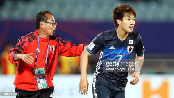 Ritsu Doan of Japan celebrates with head coach Atsushi Uchiyama after scoring a goal during the FIFA U20 World Cup Korea Republic 2017 group D match...