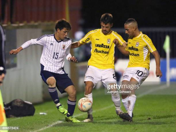 Ritsu Doan of Japan fights for the ball against Mario Pokar of F91 and Yassine Benajiba of F91 during a friendly soccer match between F91 Diddeleng...