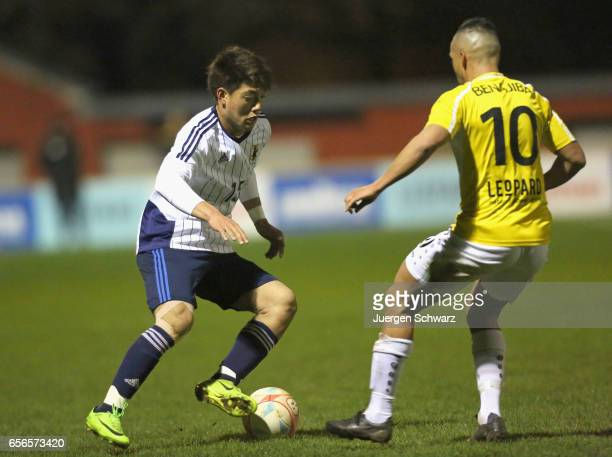 Ritsu Doan of Japan tackles Yassine Benajiba of F91 during a friendly soccer match between F91 Diddeleng and the Japan U20 team at Stade Jos Nosbaum...