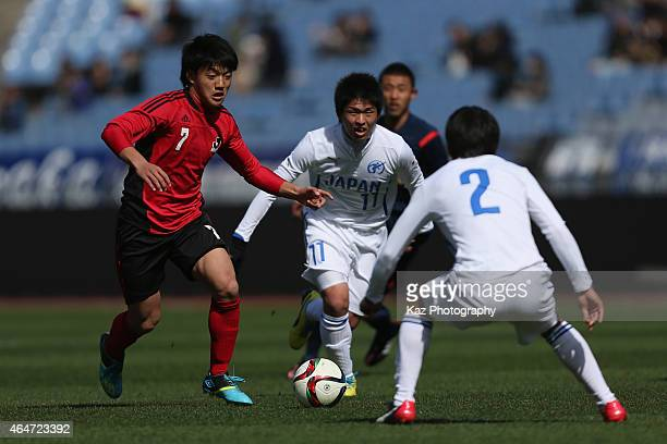 Ritsu Doan of U18 JLeague XI in action during the Next Generation Match between U18 JLeague XI and Japan High School XI at Nissan Stadium on February...