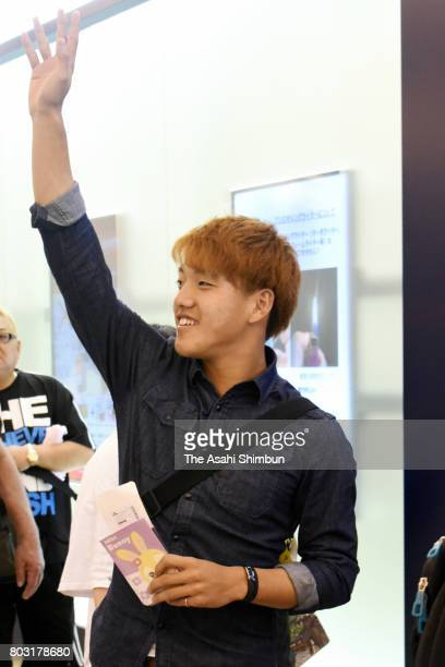 Ritsu Doan who will join Dutch side Groningen waves on departure at Kansai International Airport on June 28 2017 in izumisano Osaka Japan