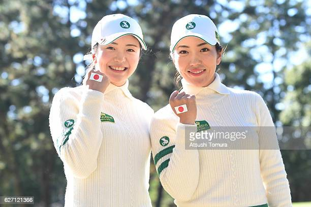 Ritsuko Ryu and Kotone Hori of Japan pose after winning the match against Florentyna Parker of England and Georgia Hall of England during the first...