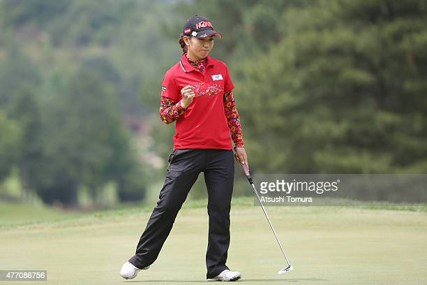Ritsuko Ryu of Japan celebrates after making her birdie putt on the 12th hole during the Suntory Ladies Open at the Rokko Kokusai Golf Club on June...