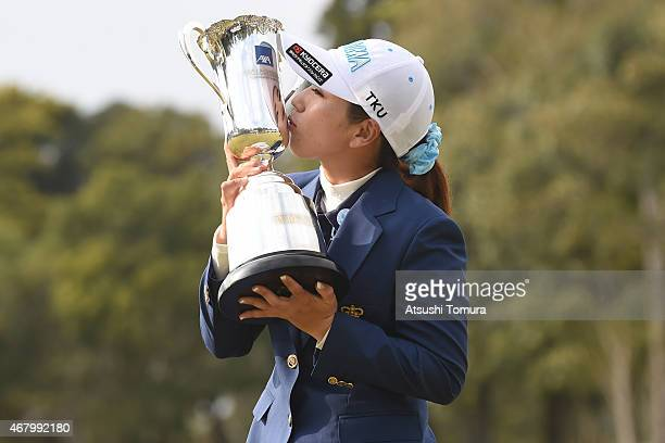 Ritsuko Ryu of Japan kisses the trophy after winning the AXA Ladies Golf Tournament at the UMK Country Club on March 29 2015 in Miyazaki Japan