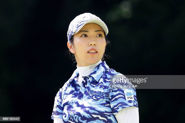 Ritsuko Ryu of Japan reacts after a tee shot on the 5th hole during the final round of the Chukyo Television Bridgestone Ladies Open at the Chukyo...