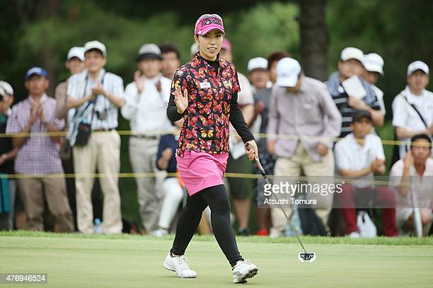 Ritsuko Ryu of Japan reacts after making her birdie putt on the 17th green during the third round of the Suntory Ladies Open at the Rokko Kokusai...