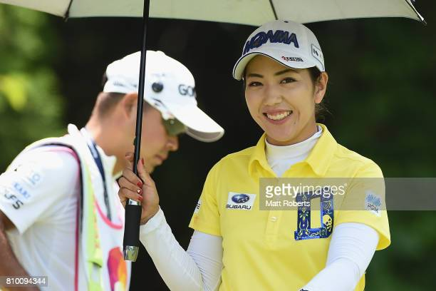 Ritsuko Ryu of Japan smiles after her tee shot on the 7th hole during the first round of the Nipponham Ladies Classics at the Ambix Hakodate Club on...