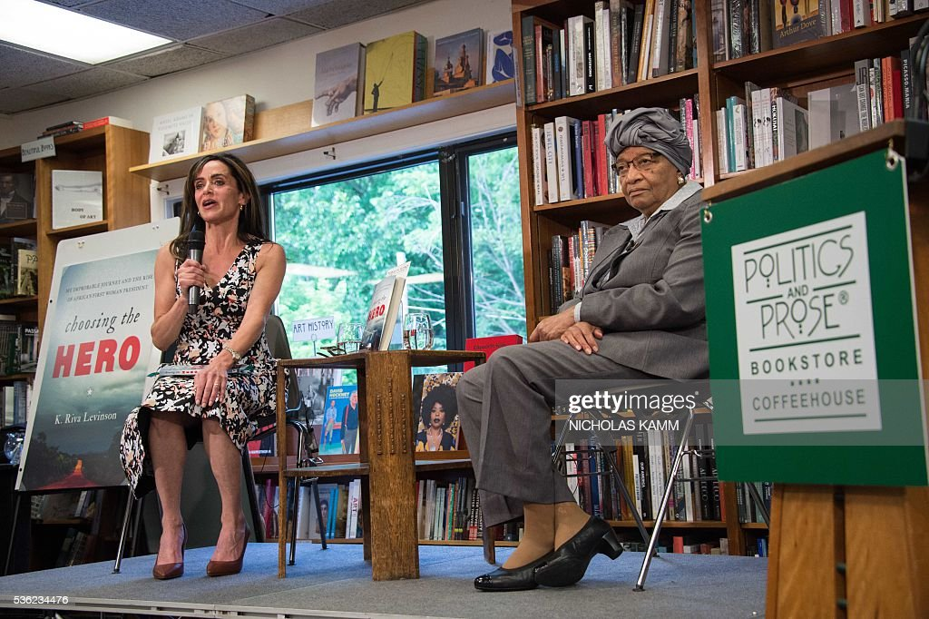 K. Riva Levinson (L), president and CEO of KRL International LLC, a Washington communications and government relations firm that serves as the consultancy of record for Liberia, speaks with Liberian President Ellen Johnson Sirleaf (R) at the launch of her book about the president at the Politics and Prose bookstore in Washington, DC, on May 31, 2016. / AFP / NICHOLAS