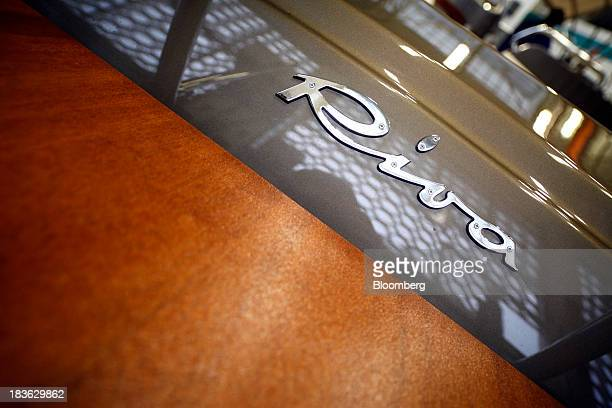 A Riva logo sits on the hull of a Rivarama Super luxury yacht manufactured by Ferretti Group at the company's shipyard in Sarnico Italy on Monday Oct...