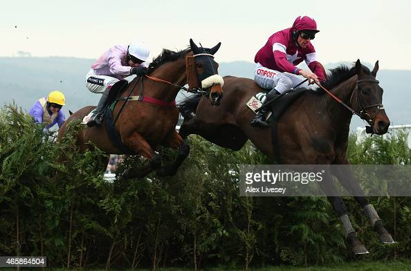 Rivage D'Or ridden by Davy Russell clears the last fence ahead of Any Currency ridden by Aidan Coleman on their way to victory in the Glenfarclas...