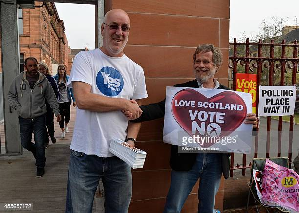 Rival campaigners shake hands outside Notre Dame Primary School polling station as the people of Scotland take to the poles to decide their country's...