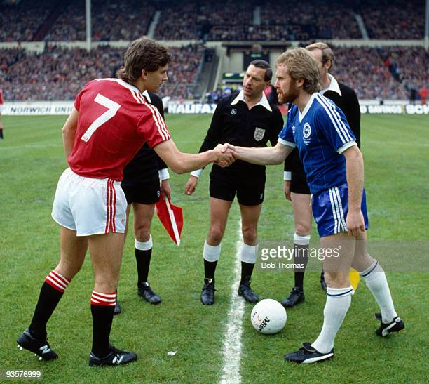Rival captains Bryan Robson of Manchester United and Tony Grealish of Brighton shake hands before the FA Cup Final between Brighton and Manchester...
