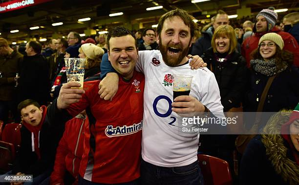 Rival fans enjoy a drink together before the RBS Six Nations match between Wales and England at Millenium Stadium on February 6 2015 in Cardiff Wales