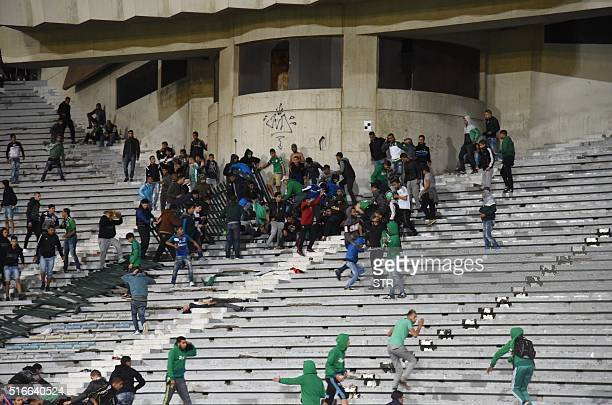 Rival fans of Raja de Casablanca football club clash at the end of a football match between their team and Chabab Rif Al Hoceima on March 19 at the...