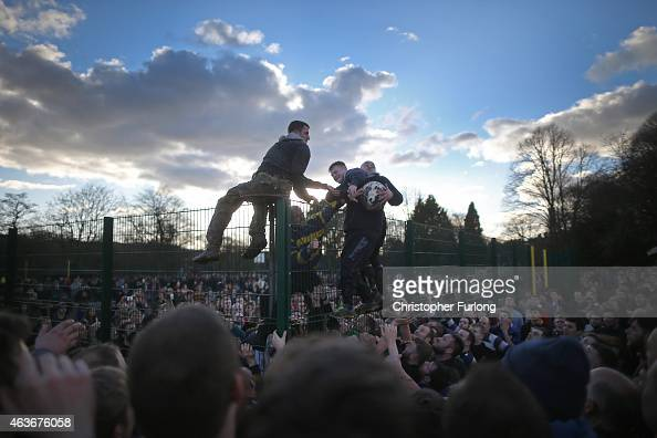 Rival teams the 'Up'ards and Down'ards' battle for the ball during the annual Ashbourne Royal Shrovetide 'no rules' football match on February 17 in...