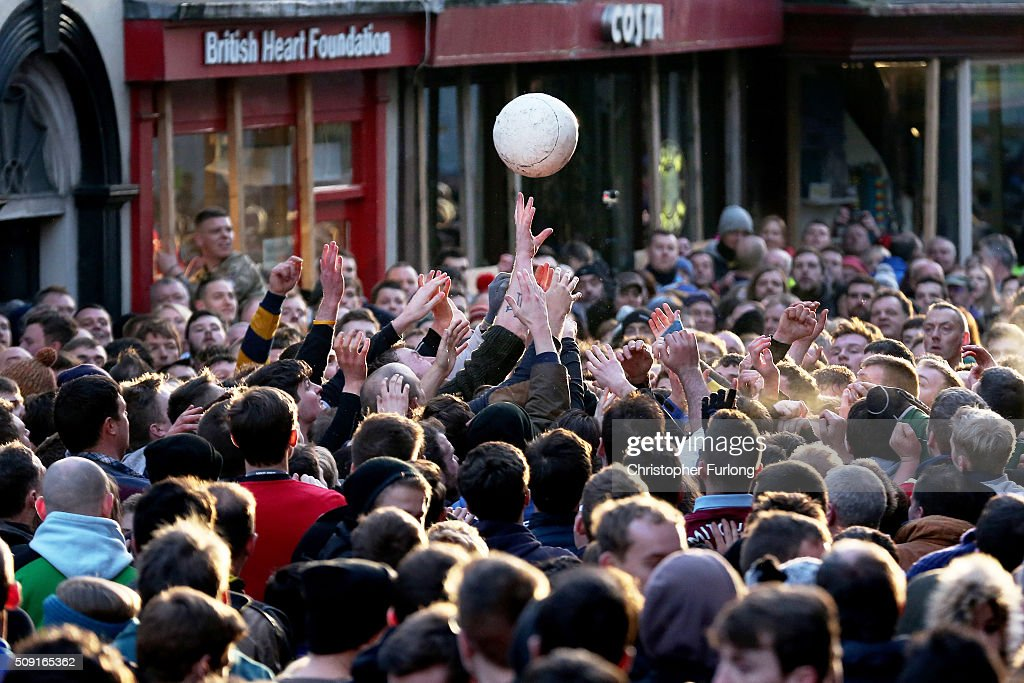 Rival teams the 'Up'ards and Down'ards' battle for the ball during the annual Ashbourne Royal Shrovetide 'no rules' football match on February 9, 2016 in Ashbourne, England. Played since the 17th Century, the annual Shrovetide Football Match sees teams from opposite ends of the Derbyshire town of Ashbourne aim to get a ball into one of two goals that are positioned three miles apart at either end of Ashboune. The game has 'no rules' and can sometimes end in injury and damage to property although volunteer stewards keep a watchful eye for any serious foul play or possible damage. The match starts on Shrove Tuesday and can last until 10 PM. If a goal is scored before 6 PM then a new ball is 'turned up' again and a new game started. If the goal is after 6 PM then the game ends for that day and continues into the next day, known as Ash Wednesday.