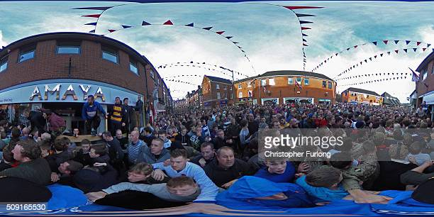 Rival teams the 'Up'ards and Down'ards' battle for the ball during the annual Ashbourne Royal Shrovetide 'no rules' football match on February 9 2016...