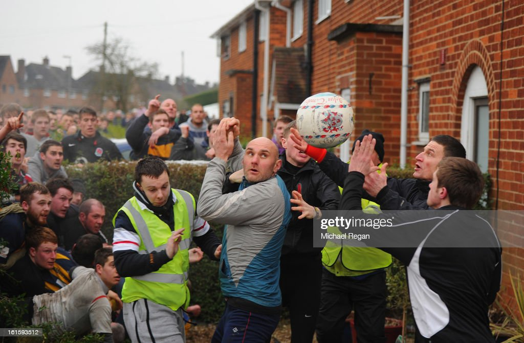 Rival teams the 'Up'ards and Down'ards' battle for the ball in a front garden during the annual Shrove Tuesday 'no rules' football match on February 12, 2013, in Ashbourne, England. First played in the 17th Century between teams from opposite ends of the Derbyshire town, hundreds of participants aim to get a ball into one of two goals that are positioned three miles apart at either end of Ashboune. The game can last until 10 PM. If a goal is scored before 6 PM, then a new ball is 'turned up' again and a new game started. If the goal is after 6 PM then the game ends for that day and continues into the next day - known as Ash Wednesday.