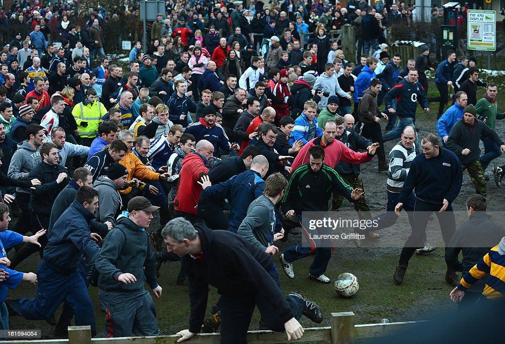 Rival teams the 'Up'ards and Down'ards' battle for the ball in the annual Shrove Tuesday 'no rules' football match on February 12, 2013, in Ashbourne, England. First played in the 17th Century between teams from opposite ends of the Derbyshire town, hundreds of participants aim to get a ball into one of two goals that are positioned three miles apart at either end of Ashboune. The game can last until 10 PM. If a goal is scored before 6 PM, then a new ball is 'turned up' again and a new game started. If the goal is after 6 PM then the game ends for that day and continues into the next day - know as Ash Wednesday.