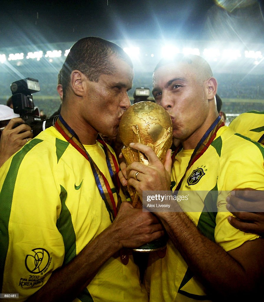 Rivaldo and Ronaldo of Brazil kiss the trophy after the Germany v Brazil, World Cup Final match played at the International Stadium Yokohama in Yokohama, Japan on June 30, 2002. Brazil won 2-0.