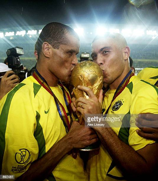 Rivaldo and Ronaldo of Brazil kiss the trophy after the Germany v Brazil World Cup Final match played at the International Stadium Yokohama in...
