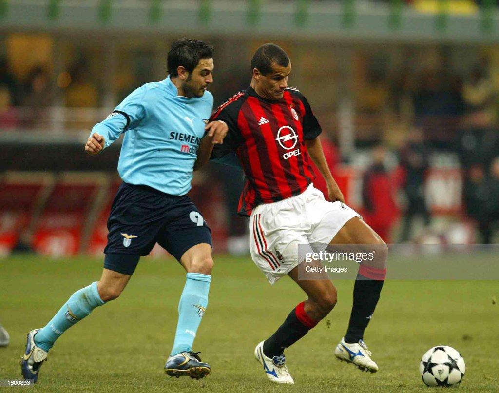 Rivaldo of AC Milan and Stefano Fiore of Lazio in action