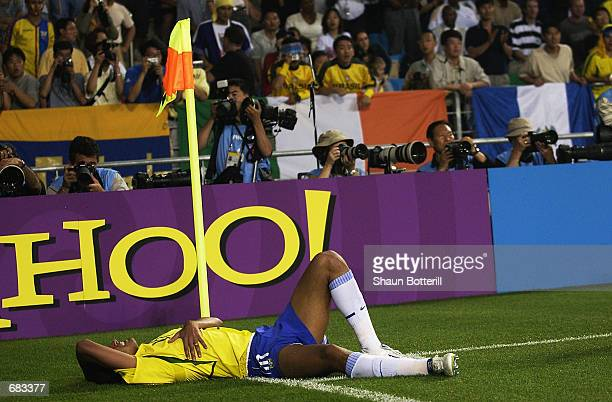 Rivaldo of Brazil feigns injury which led to the sending off of Hakan Unsal of Turkey during the Group C match of the World Cup Group Stage played at...