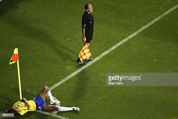 Rivaldo of Brazil lies on the ground after being struck by the ball during the Group C match against Turkey at the World Cup Group Stage played at...