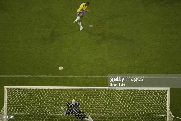 Rivaldo of Brazil scores the winning goal from the penalty spot as Brazil defeat Turkey 21 during the second half during the Brazil v Turkey Group C...