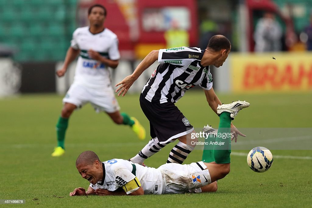 <a gi-track='captionPersonalityLinkClicked' href=/galleries/search?phrase=Rivaldo&family=editorial&specificpeople=208828 ng-click='$event.stopPropagation()'>Rivaldo</a> #7 of Figueirense tackles Alex #10 of Coritiba during a match between Figueirense and Coritiba as part of Campeonato Brasileiro 2014 at Orlando Scarpelli Stadium on October 19, 2014 in Florianopolis, Brazil