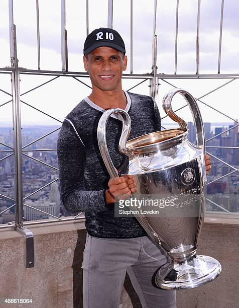 Rivaldo poses with the UEFA Champions League trophy on top of the Empire State Building on March 17 2015 in New York City The trophy was in New York...