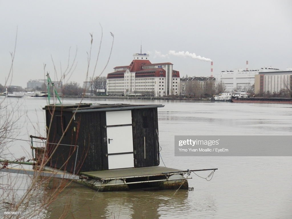 River Against Buildings And Factory : Stock-Foto