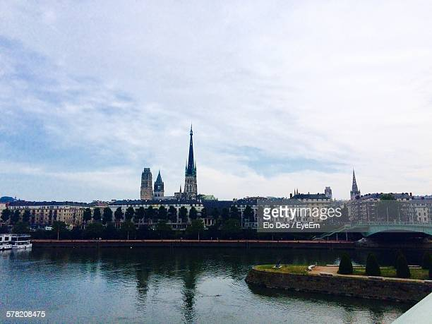 River Against Rouen Cathedral In City Against Cloudy Sky